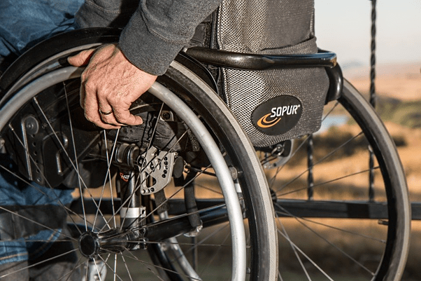 Photo of man in wheelchair